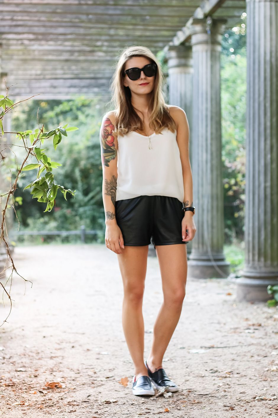 black leather shorts with a white tank top