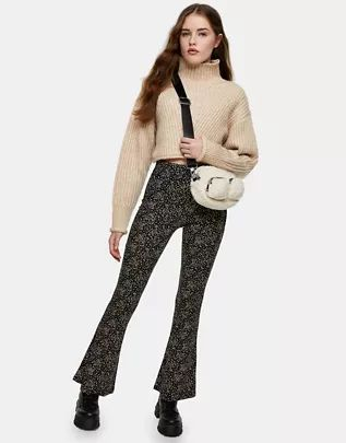 floral print flared trousers in black