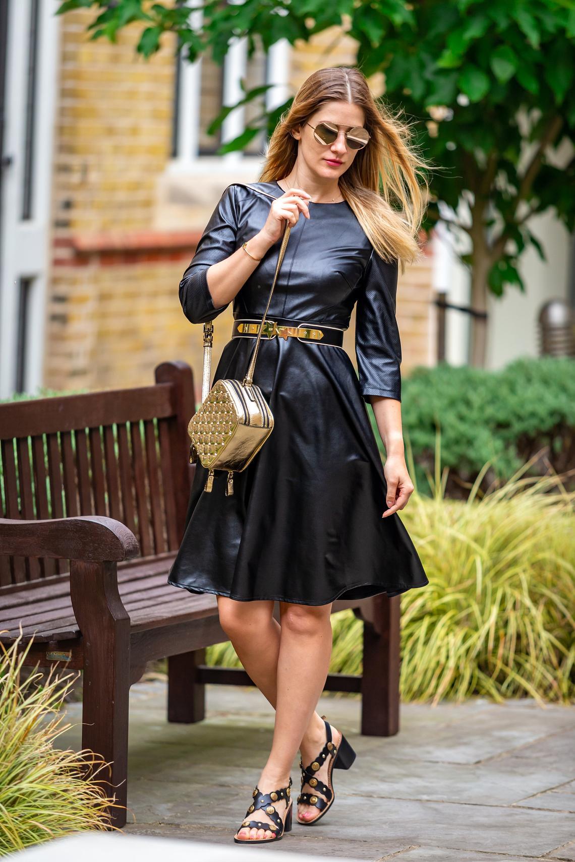 Leather look semi shine black skater dress