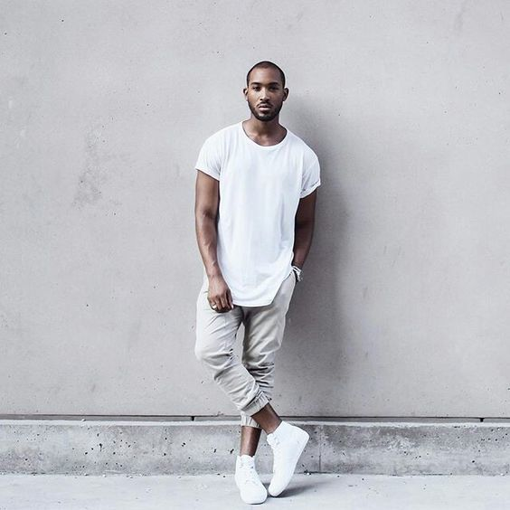 A pair of white T-shirt or grey sweat pants