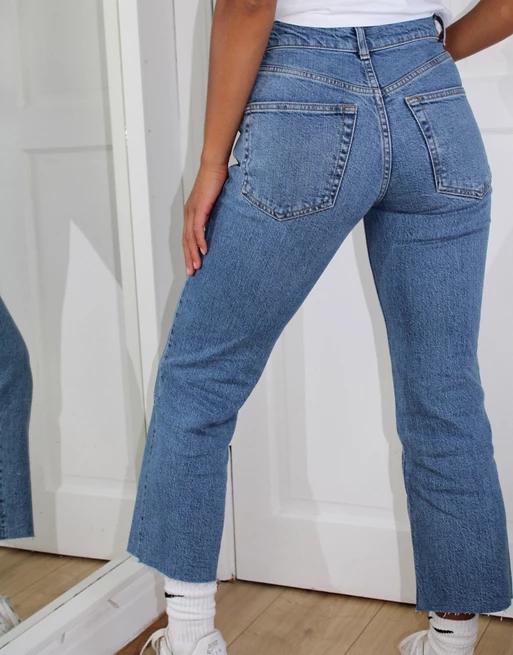 ASOS DESIGN Petite high rise stretch 'effortless' crop kick flare jeans in vintage midwash