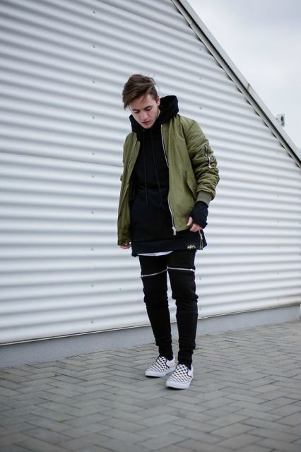 green hoodie with black tees and printed shoes