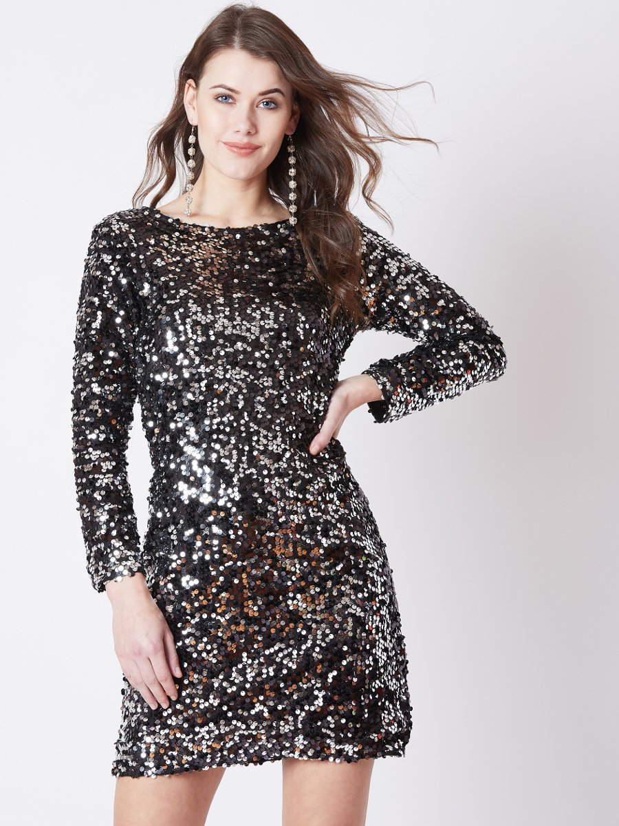 long sleeve black dress paired with a piece of stylish jewellery