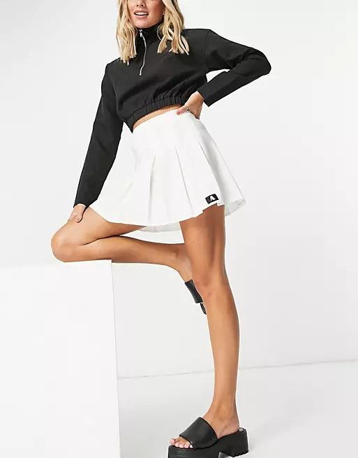 mini pleated tennis skirt with tab detail in white