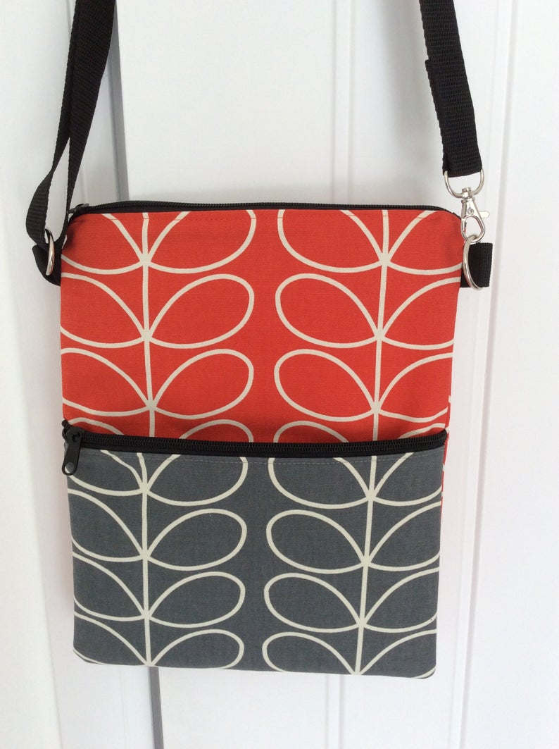 Cross body bag with four pockets in Orla Kiely patterned fabric