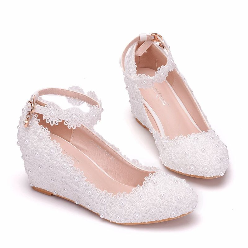 woman bridal ankle straps white lace pearls wedding shoes