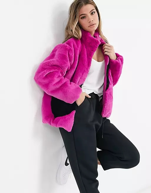 Nike faux fur oversized swoosh jacket in purple