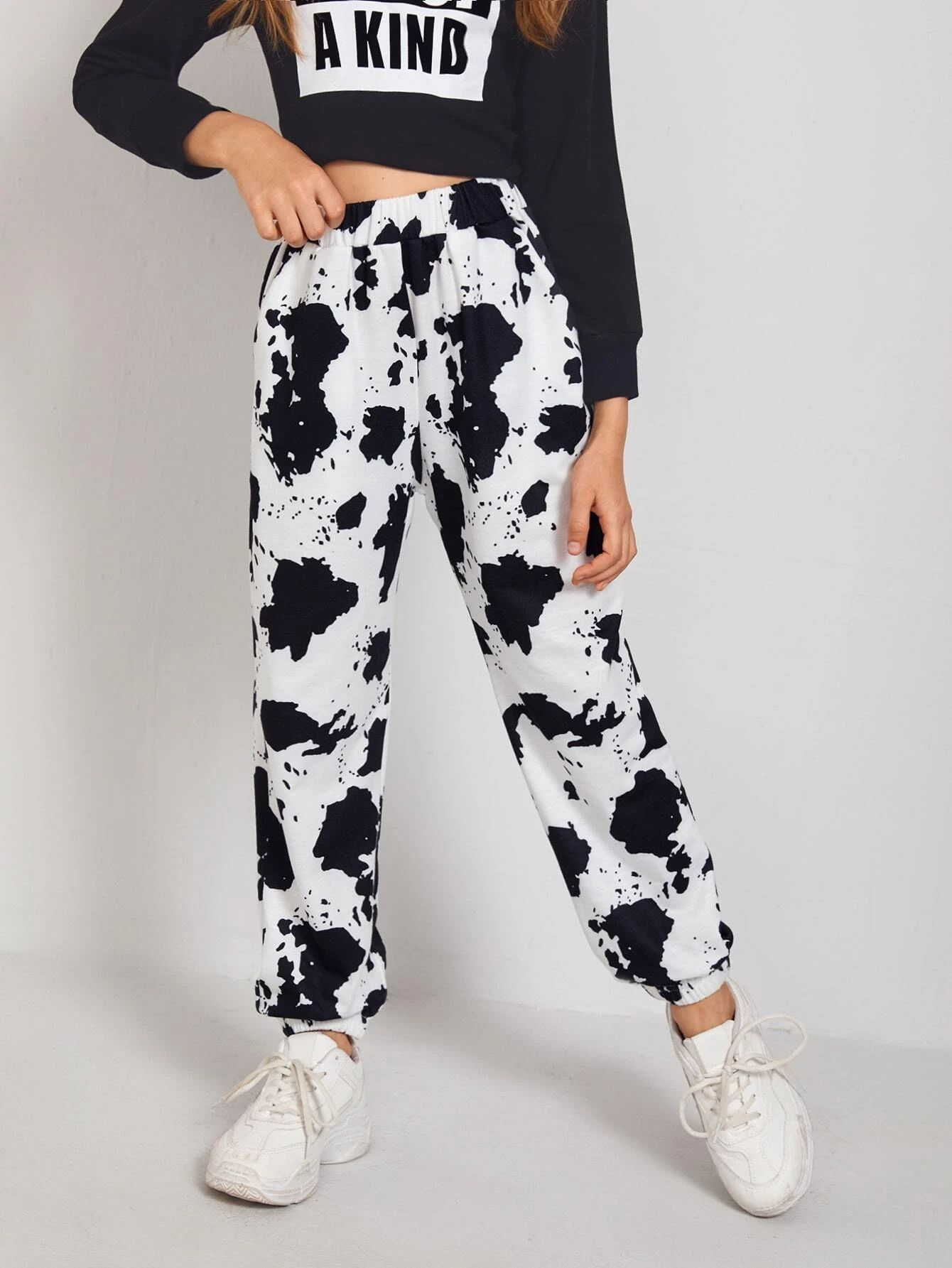 SHEIN Girls Slant Pocket Cow Print Trousers