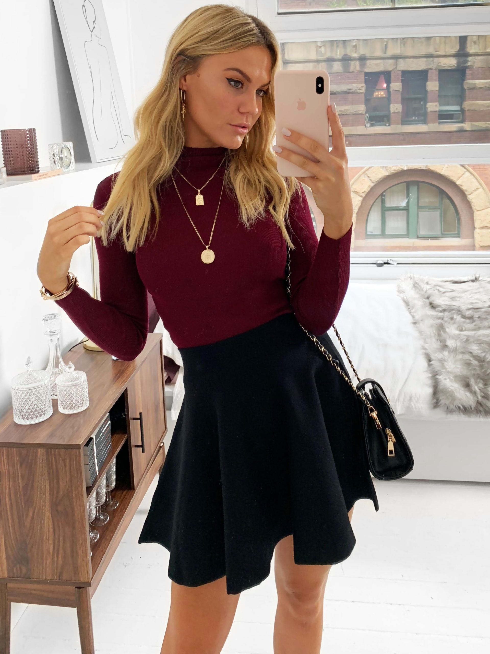 Work in a black skirt